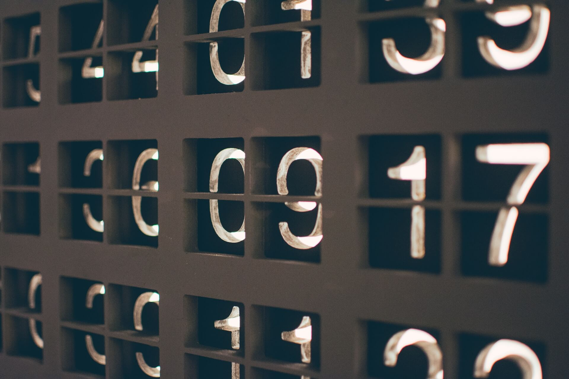 Analog numbers in white against a black background