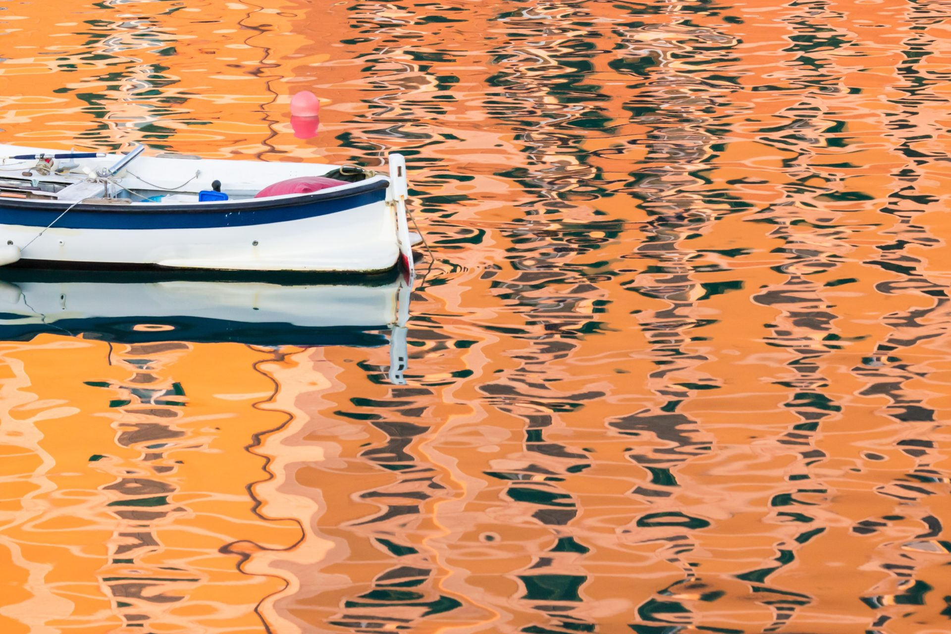 Canoe on Orange Reflective Water