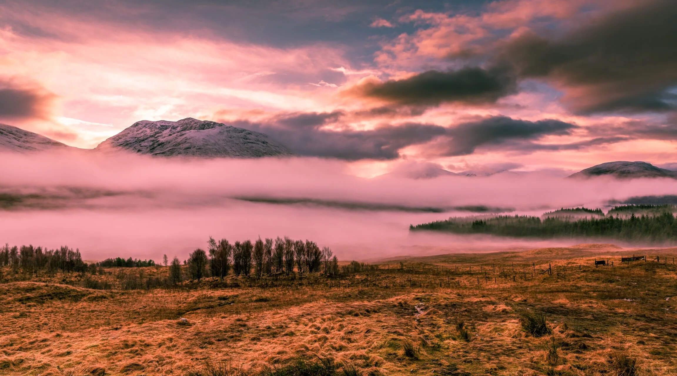 Pink Clouds in Front of Mountain