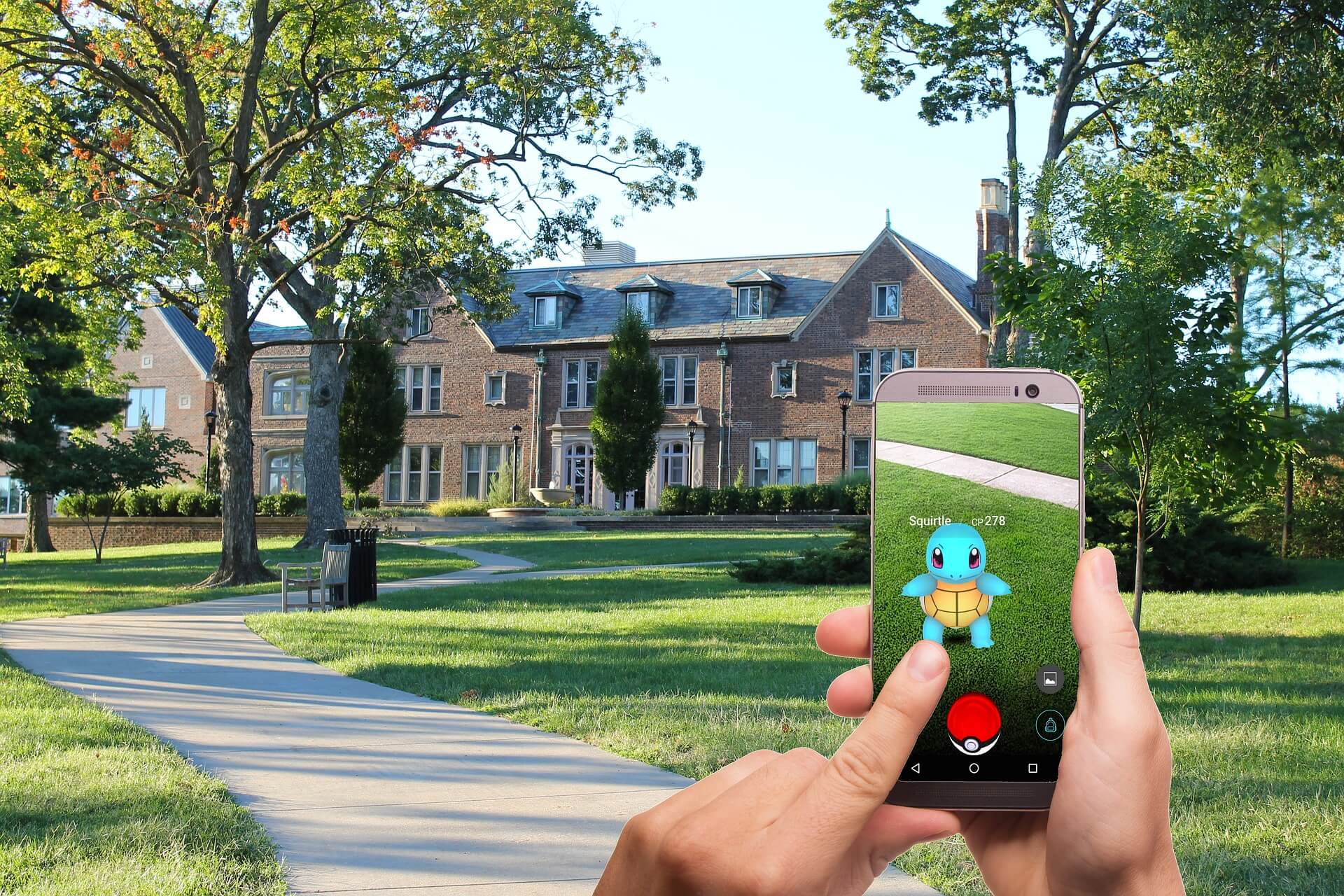 Person playing Pokemon Go on their phone and attempting to capture a Squirtle