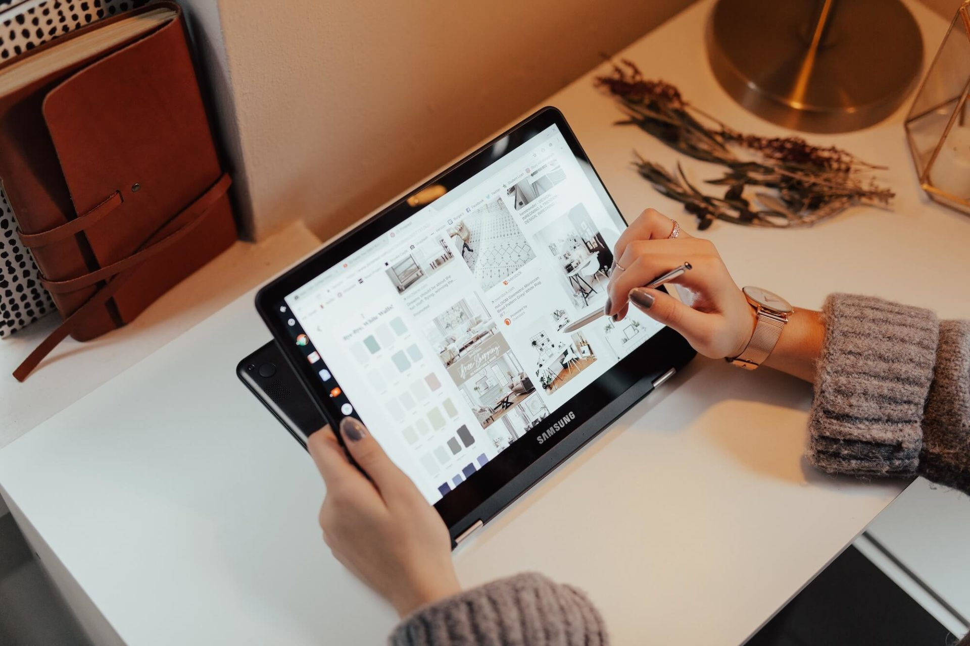 Woman scrolling through Pinterest on her tablet
