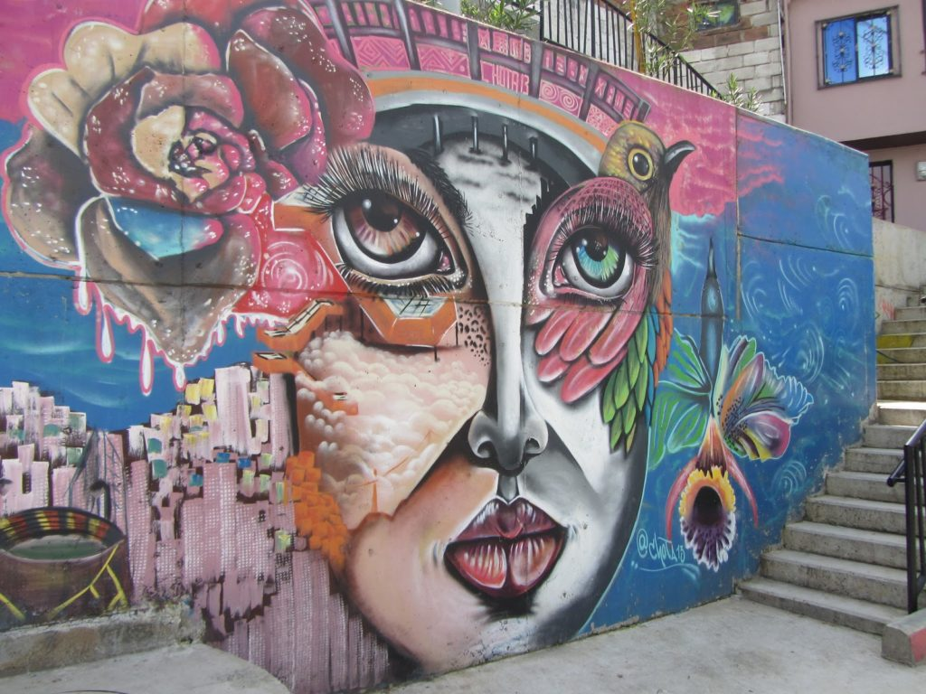 Street mural of a woman's face in Comuna 13