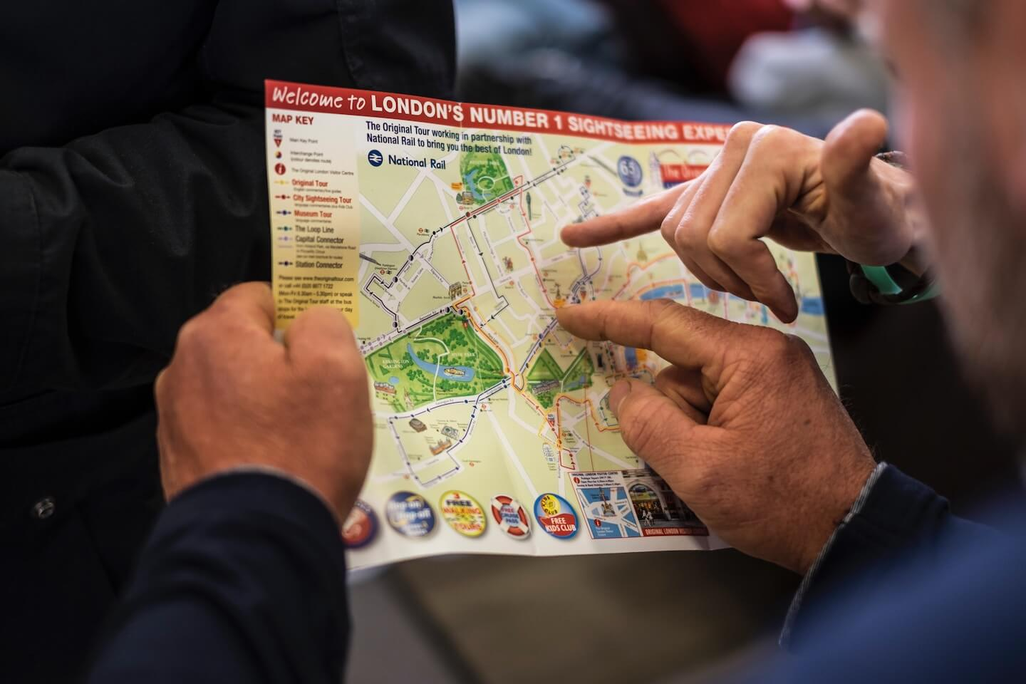 People pointing at a spot on a map