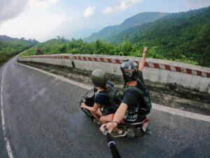 happy people on a motorbike