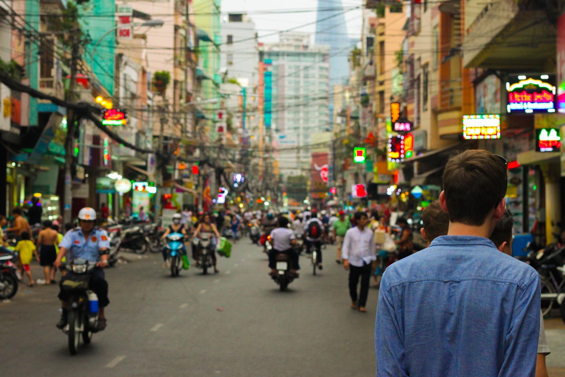 Man on a busy Asian street