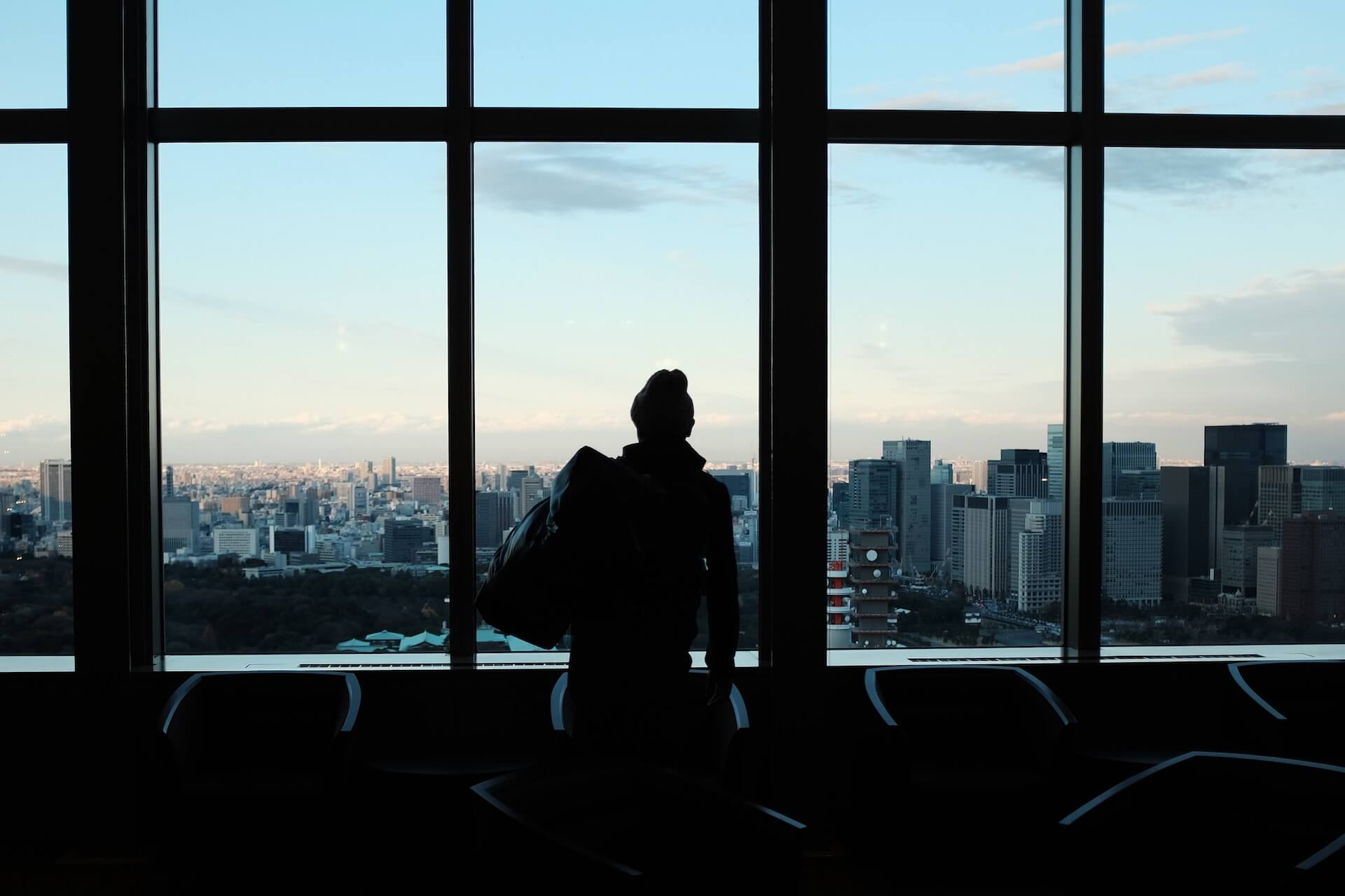 Woman looking at the city from an airport window