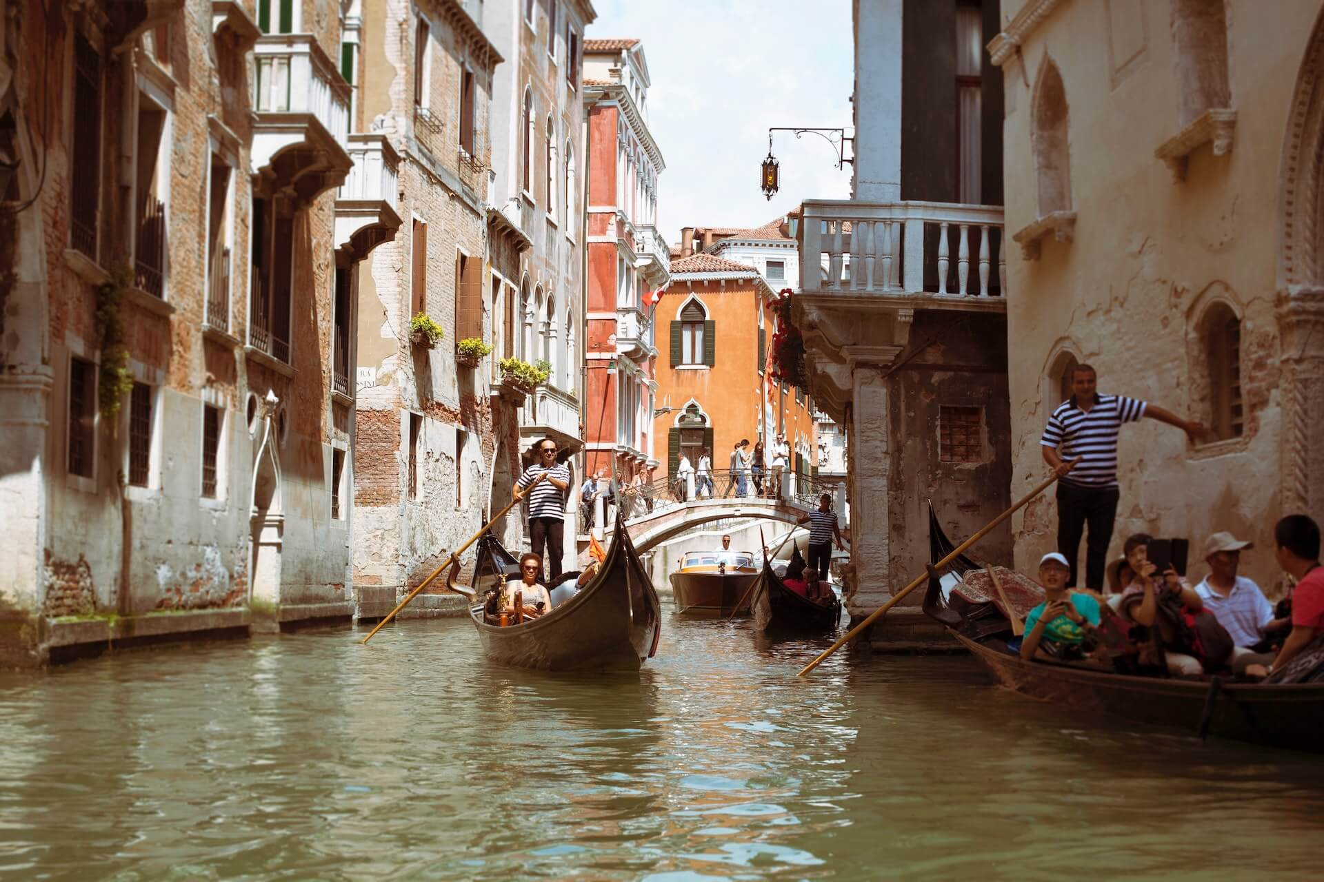 two boats full of people on the canals of venice