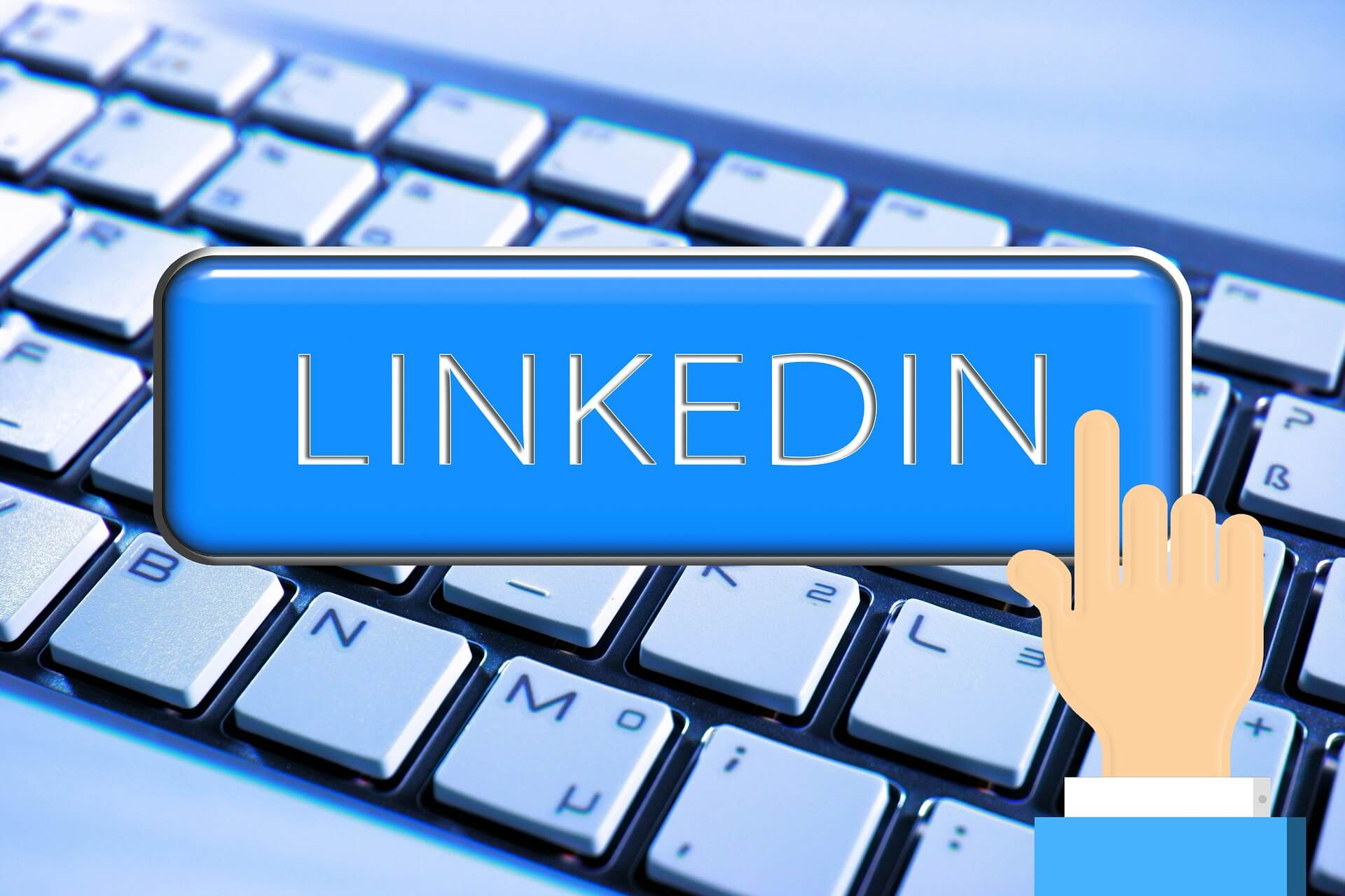 Animated hand holding a LinkedIn button over a keyboard