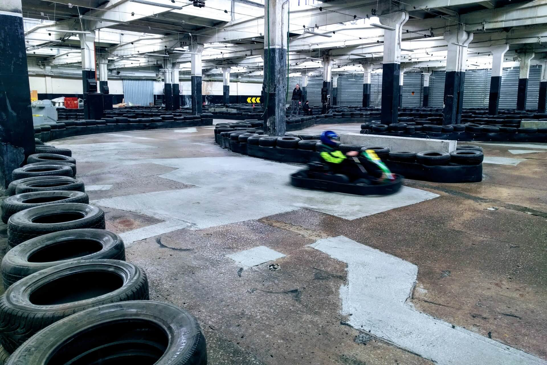 A person on a go-kart rounds a corner - tips for tour operators and activity centres.