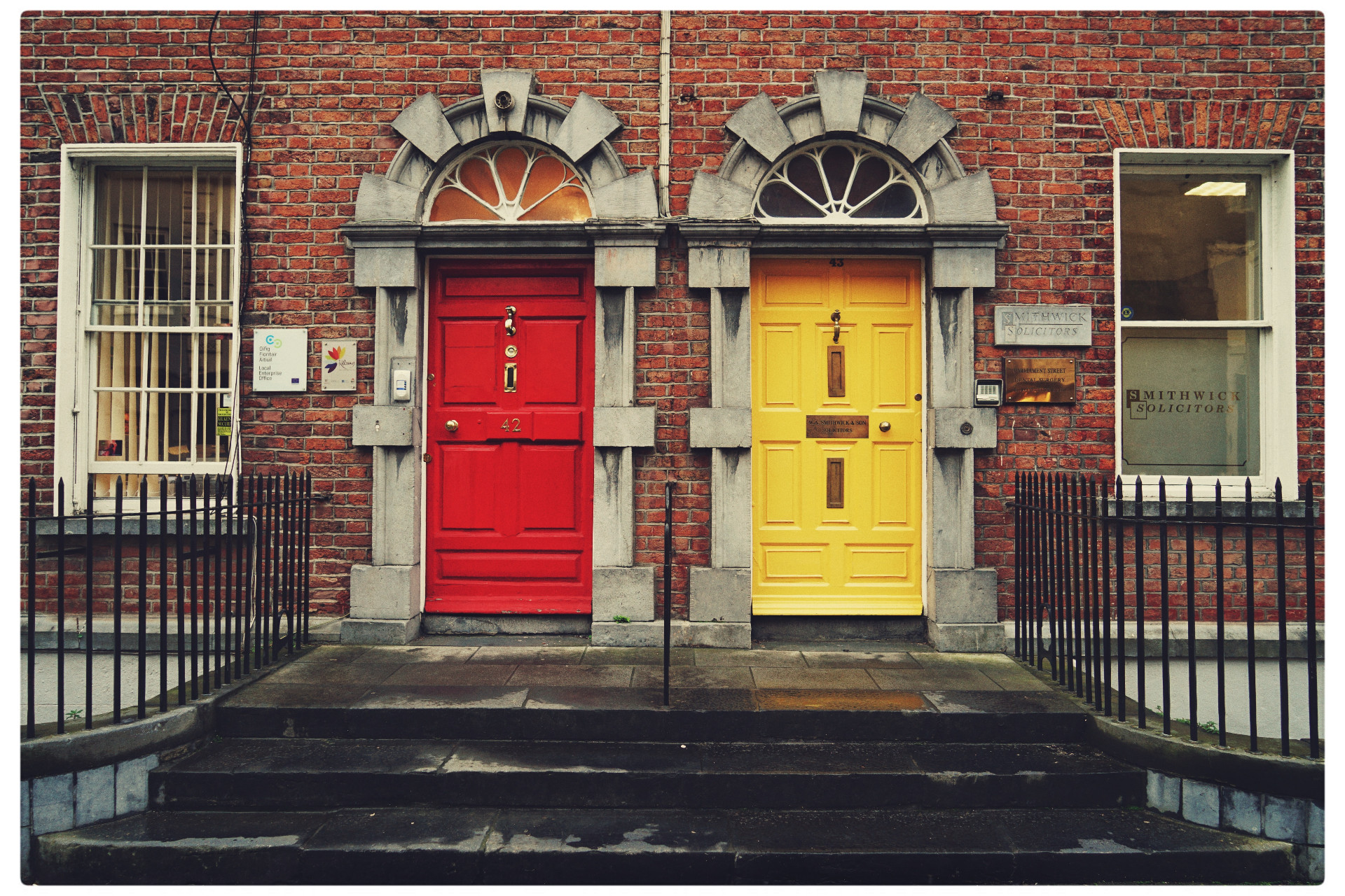 A red and yellow door next to each other