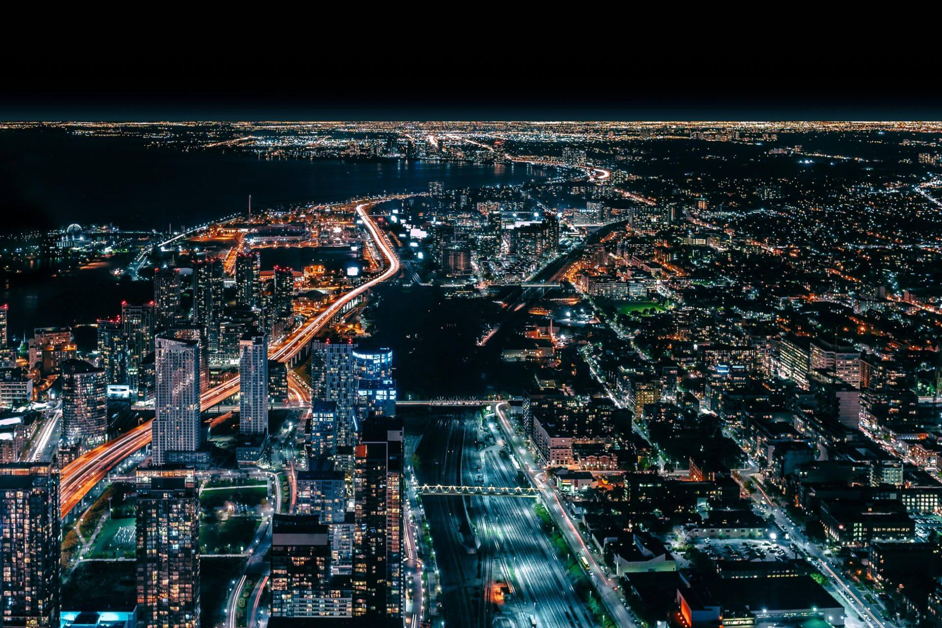 Birds eye view of a twinkling city at night time