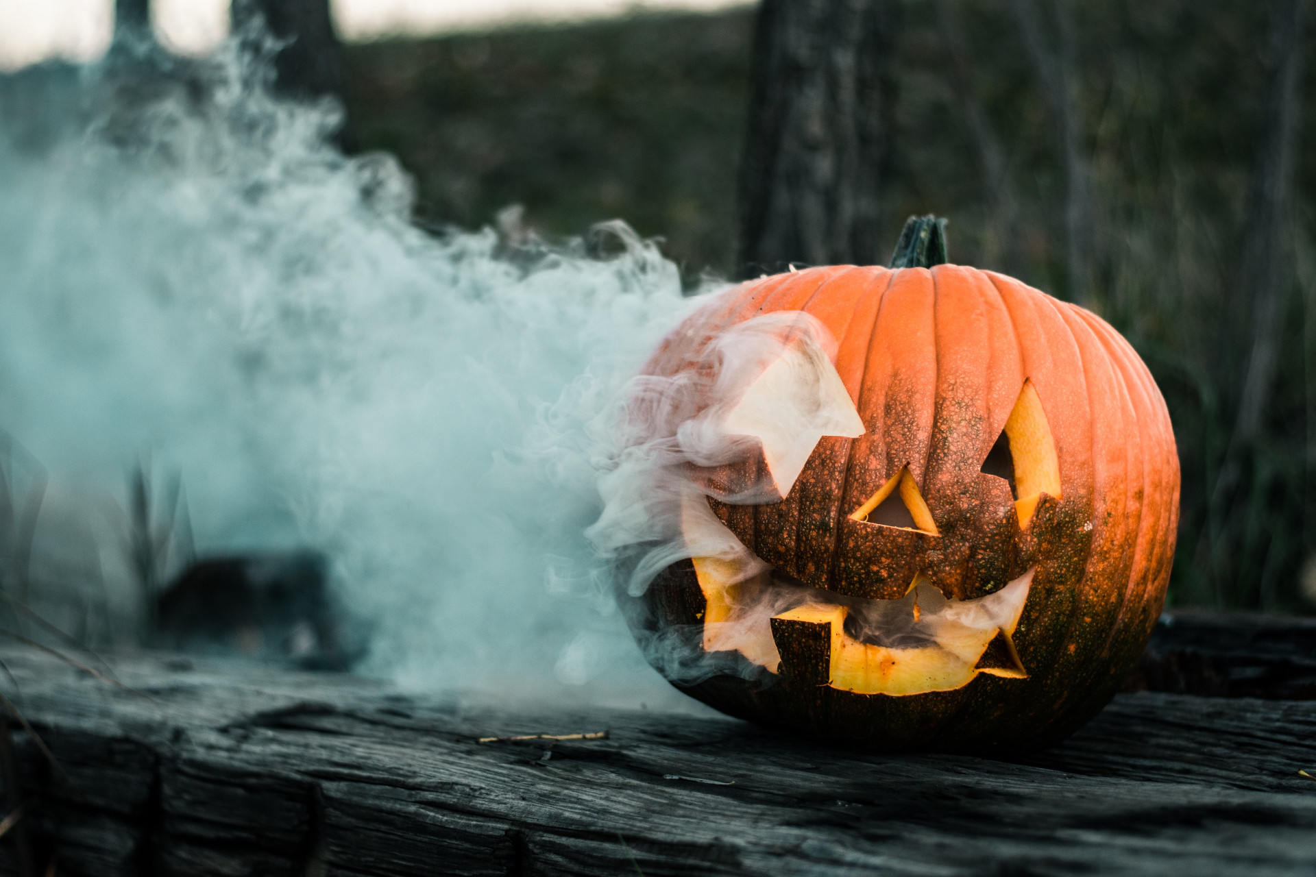 A jacko-lantern with smoke billowing out of the side