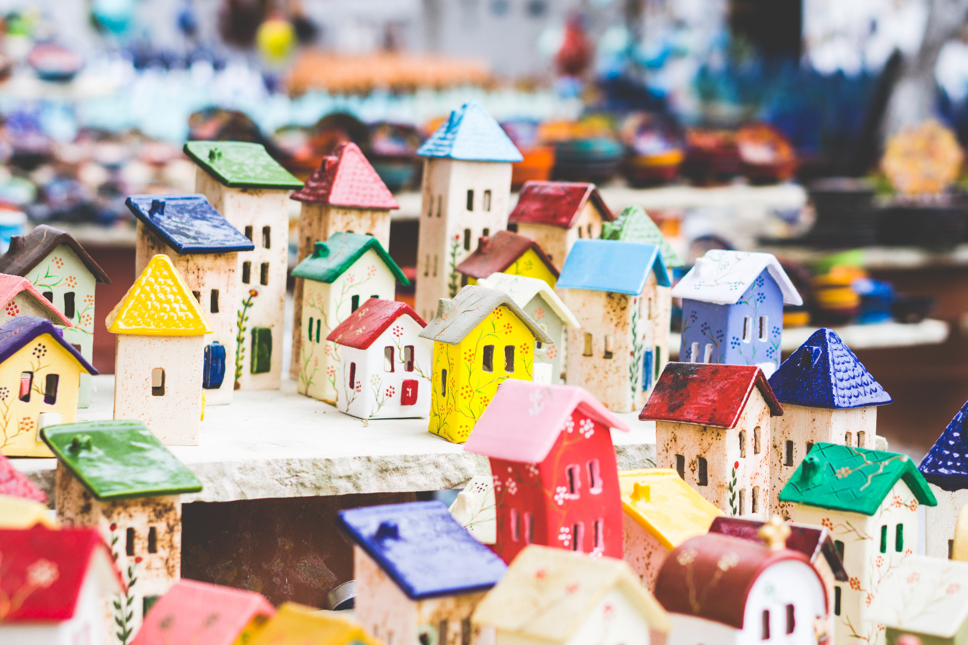 Small colorful porcelain houses on a display table