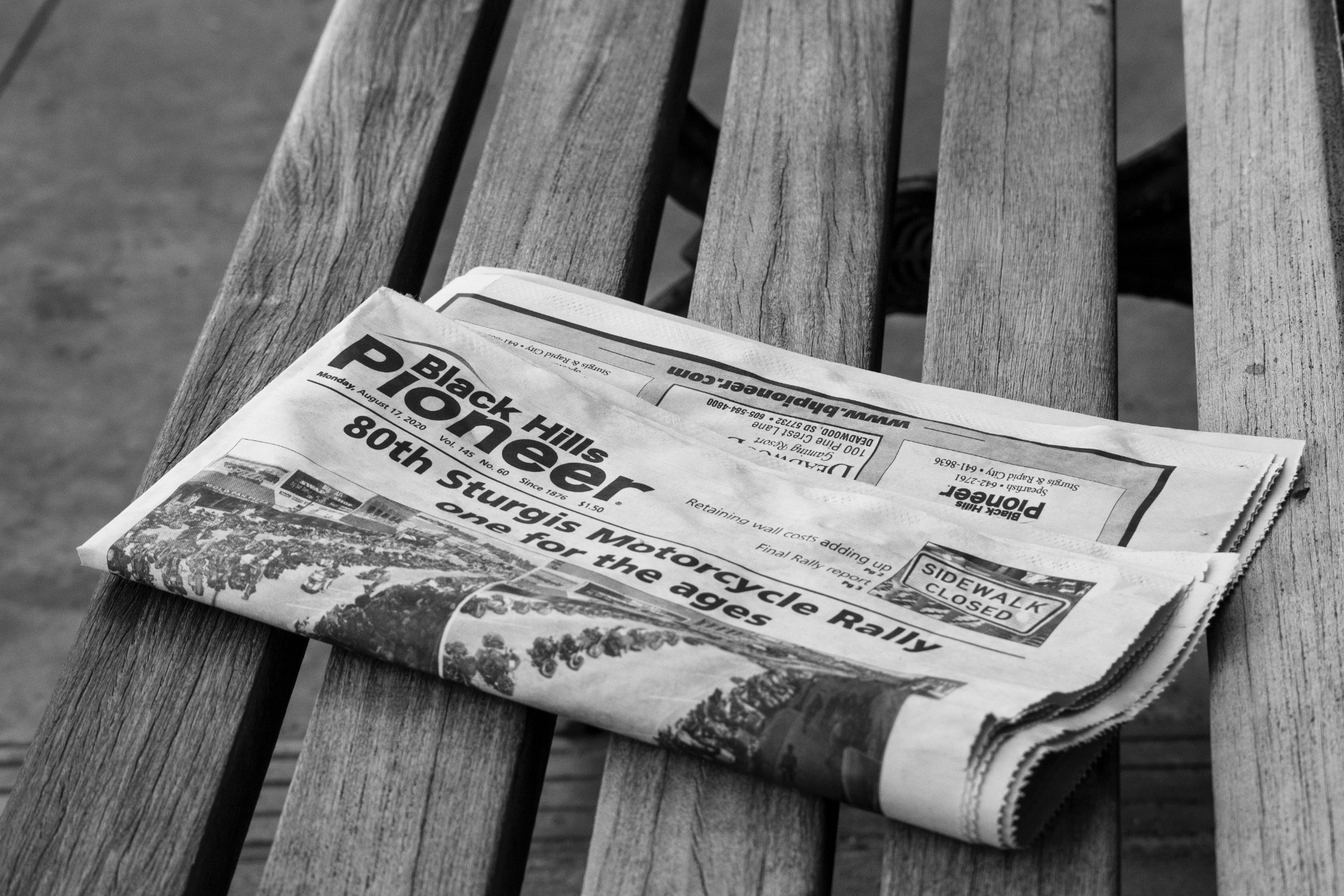 A greyscale image of a newspaper showing it