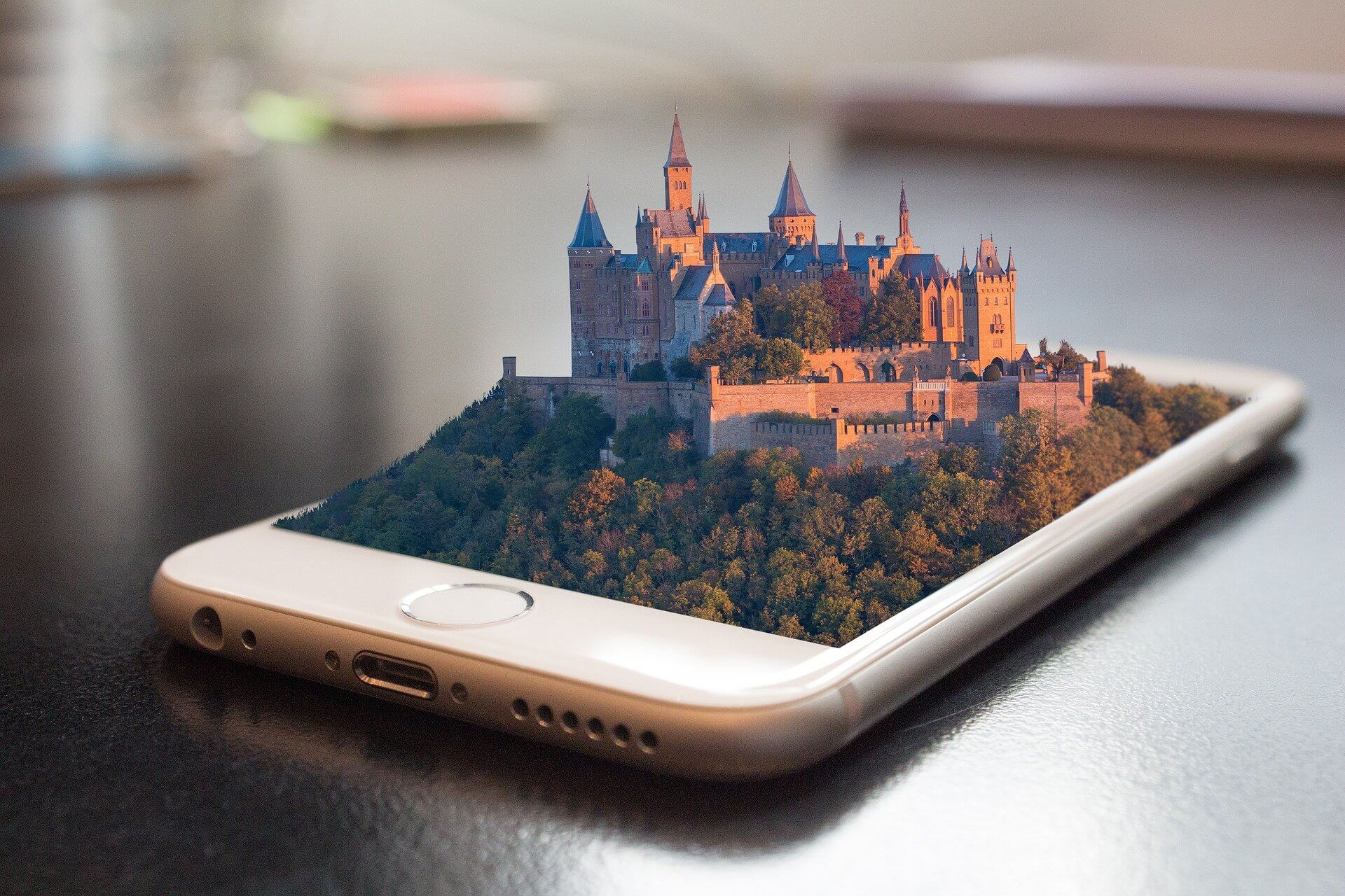 A virtual castle emerging from a cell phone screen