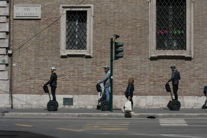 A group of people riding segways