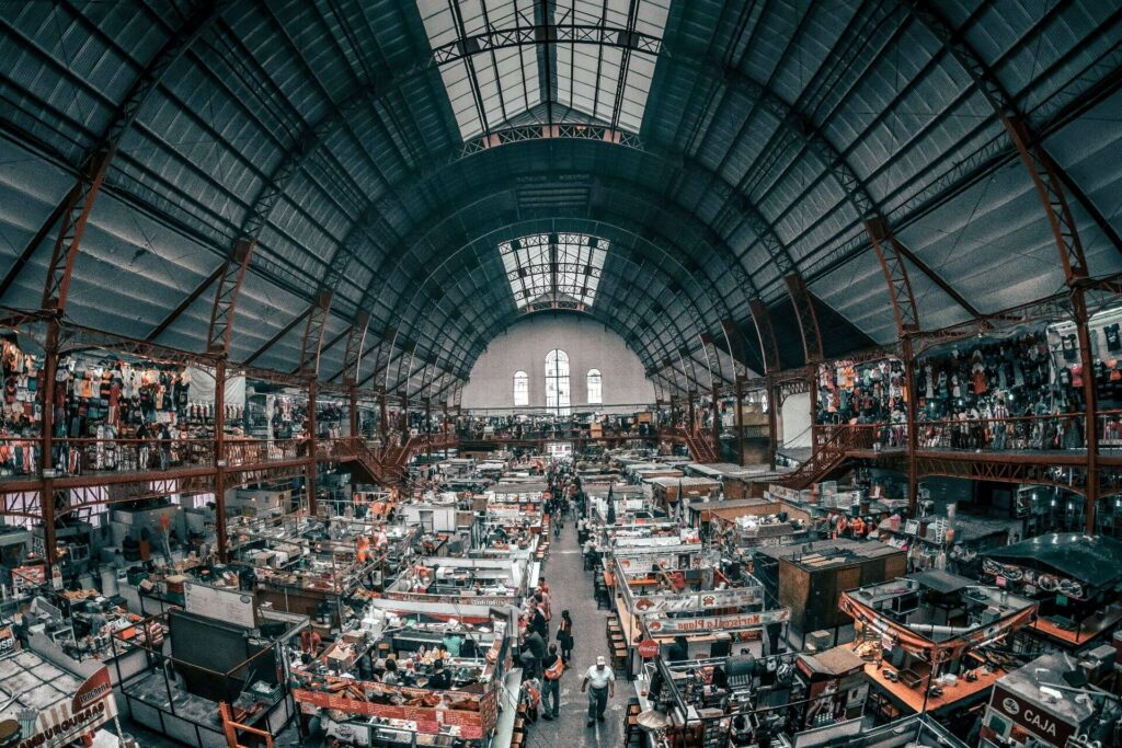 An indoor market with different types of vendors
